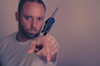 метание ножа